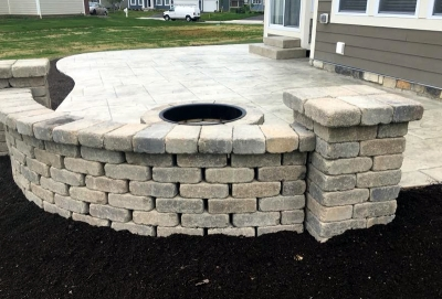 Custom Concrete Plus-stamped concrete patio with stacked stone wall in Columbus Ohio